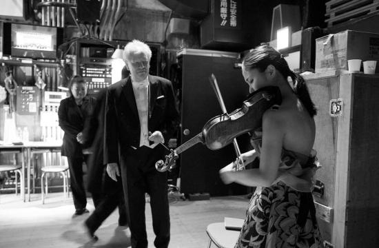 Jiří Bělohlávek and Sayaka Shoji share the last moments before the start of the performance while the audience waits excitedly.